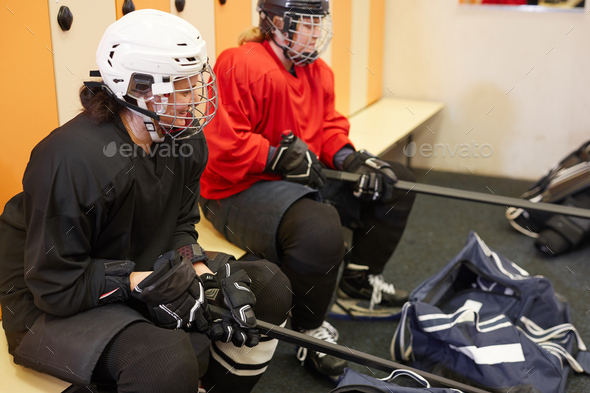 Hockey Players Getting Ready in Locker Room - Stock Photo - Images