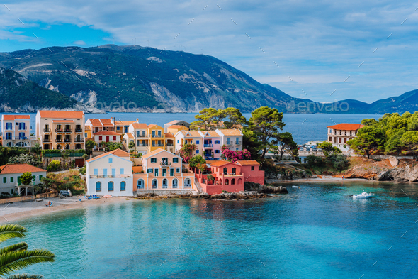 Beautiful panoramic view of Assos village with vivid colorful houses near blue turquoise colored and - Stock Photo - Images