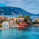 Beautiful panoramic view of Assos village with vivid colorful houses near blue turquoise colored and - PhotoDune Item for Sale