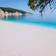Amazing Fteri beach lagoon, Kefalonia, Greece. Tourists under umbrella chill relax near clear blue - PhotoDune Item for Sale