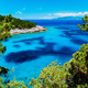 Azure hidden bay on greek island. Crystal clear water on sunny summerday - PhotoDune Item for Sale