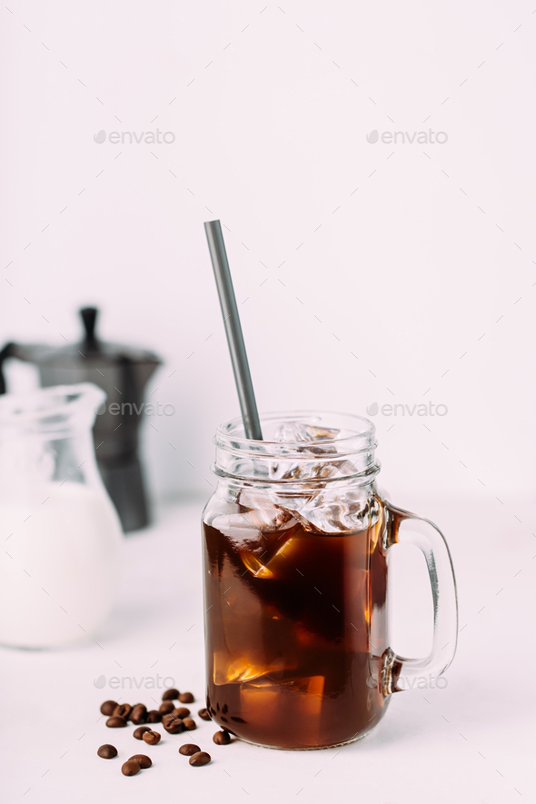 Iced coffee drink on glass jar with straw. - Stock Photo - Images