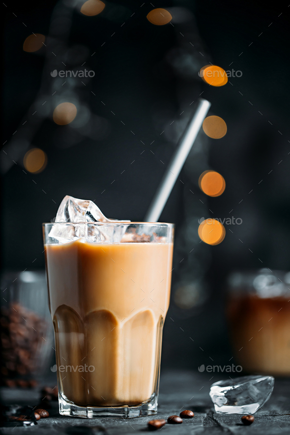 Iced coffee with milk in tall glass - Stock Photo - Images
