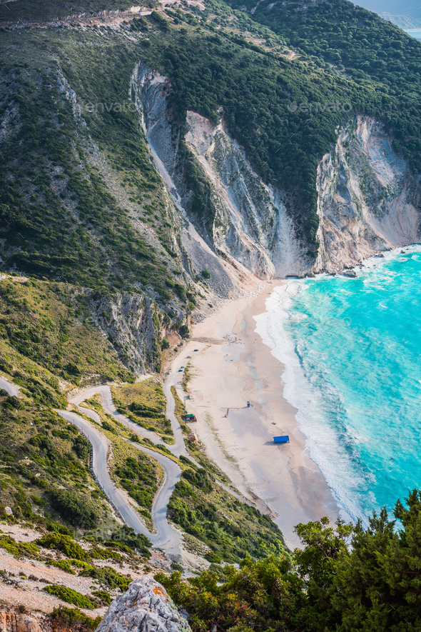 Tourist tent on famous Myrtos Beach. Big foam waves rolling towards the bay. Kefalonia, Greece - Stock Photo - Images