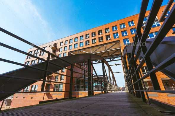 Famous landmark old Speicherstadt in Hamburg, build with red bricks. Bridge in low angle view - Stock Photo - Images