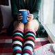 woman holding blue cup with cocoa and marshmallow - PhotoDune Item for Sale