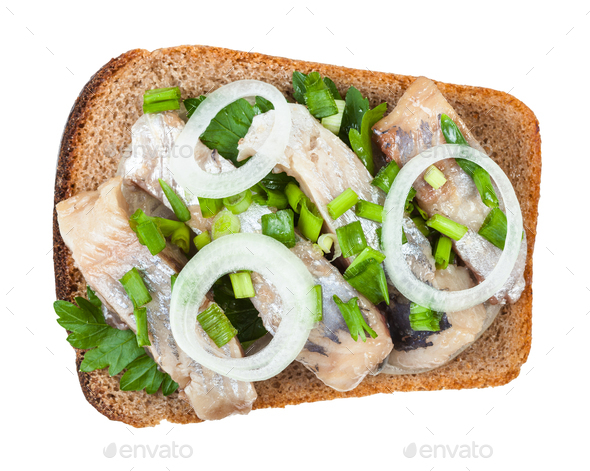 top view of open sandwich salted herring and onion - Stock Photo - Images