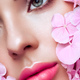 Portrait of beautiful young woman with flowers - PhotoDune Item for Sale