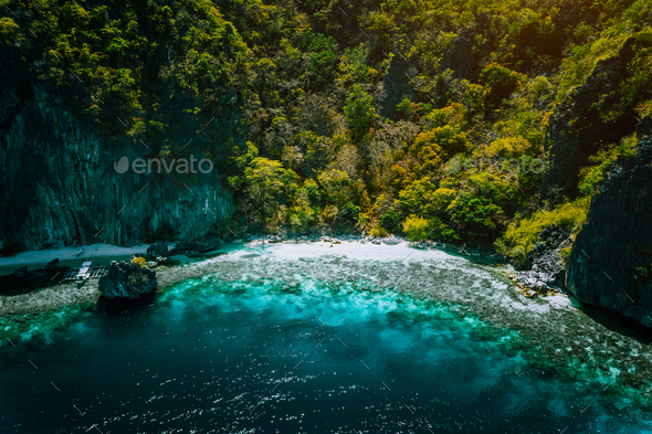 El Nido, Palawan, Philippines, aerial view of banca boat, karst mountain wall pristine sand beach - Stock Photo - Images