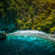 El Nido, Palawan, Philippines, aerial view of banca boat, karst mountain wall pristine sand beach - PhotoDune Item for Sale