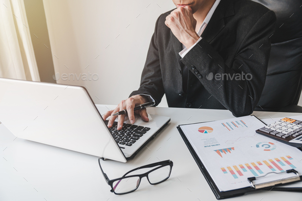 Businessman working on Desk office with marketing graph statistics analysis - Stock Photo - Images