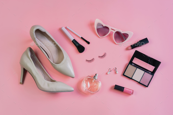 Woman cosmetics, accessories and fashion items on pink background, Top view - Stock Photo - Images