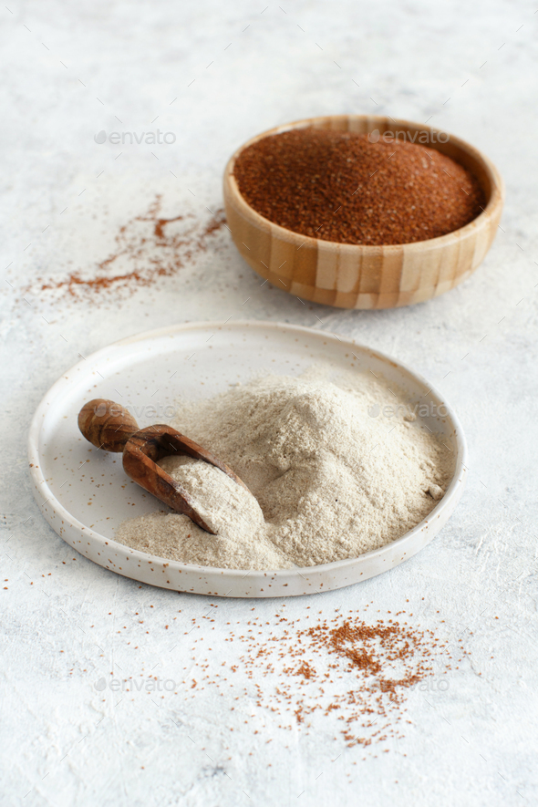 Teff flour on a plate and teff grain in a bowl - Stock Photo - Images