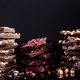 Stack of Broken Chocolate Pieces on Black Background. Copy Space. Closeup View - PhotoDune Item for Sale