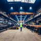 Engineer walking in large factory, blue-collar workers at work. - PhotoDune Item for Sale
