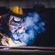 Worker welding in a factory. - PhotoDune Item for Sale