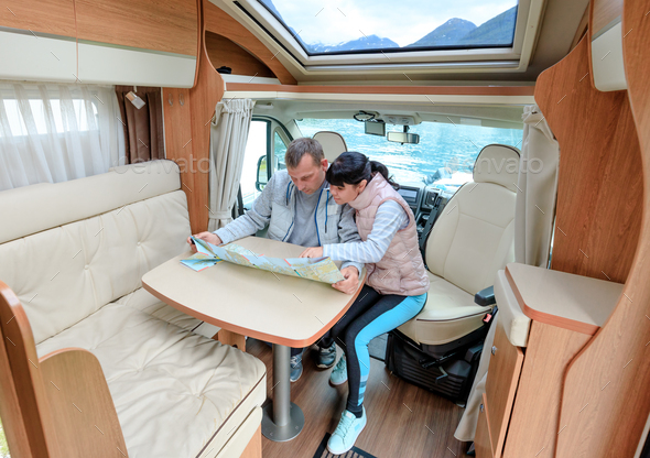 Couples in RV Camper looking at the local map for the trip. - Stock Photo - Images