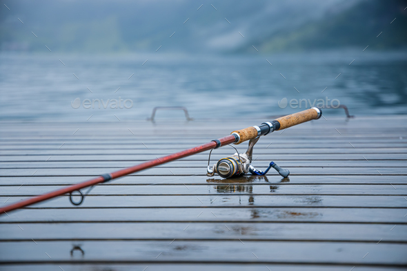 Fishing rod spinning blurred background - Stock Photo - Images