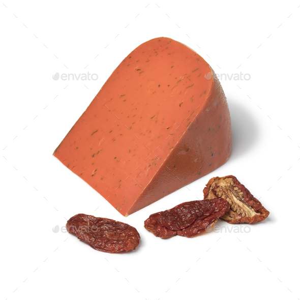 Piece of red pesto gouda cheese - Stock Photo - Images
