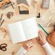 Female carpenter reading DIY project instruction manual - PhotoDune Item for Sale