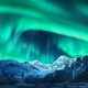 Aurora borealis above snow covered mountain range in europe - PhotoDune Item for Sale