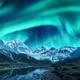 Northern lights above snow covered rocks. Winter landscape - PhotoDune Item for Sale
