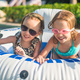 Little adorable girls swimming in the swimmingpool - PhotoDune Item for Sale