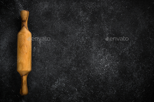 Baking background on black with rolling pin - Stock Photo - Images