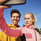 Selfie of young couple after workout on the fresh air - PhotoDune Item for Sale