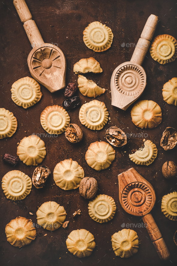 Flat-lay of Turkish traditional Hatay semolina cookies with walnut filling - Stock Photo - Images