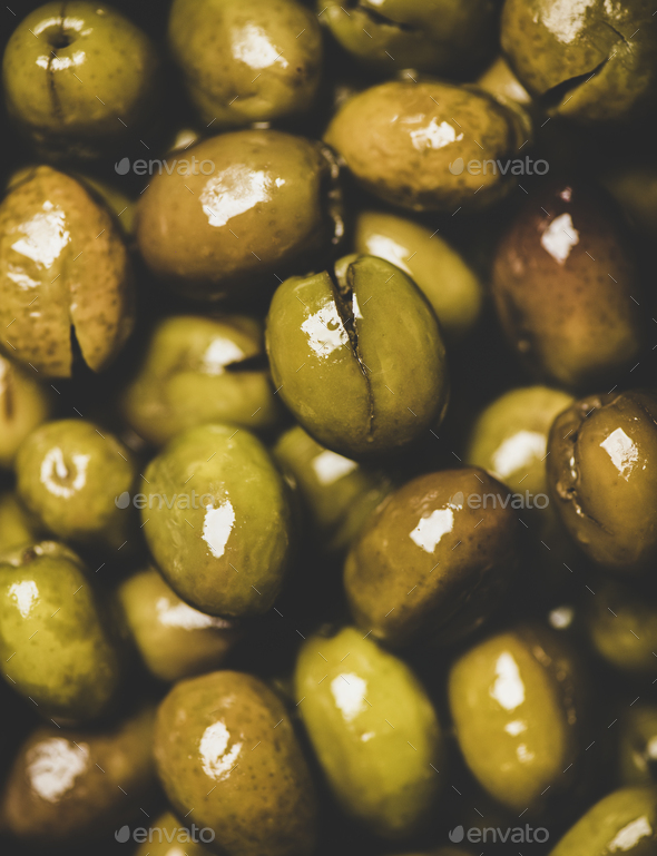 Flat-lay of fresh harvested shiny seasonal pickled green Mediterranean olives - Stock Photo - Images