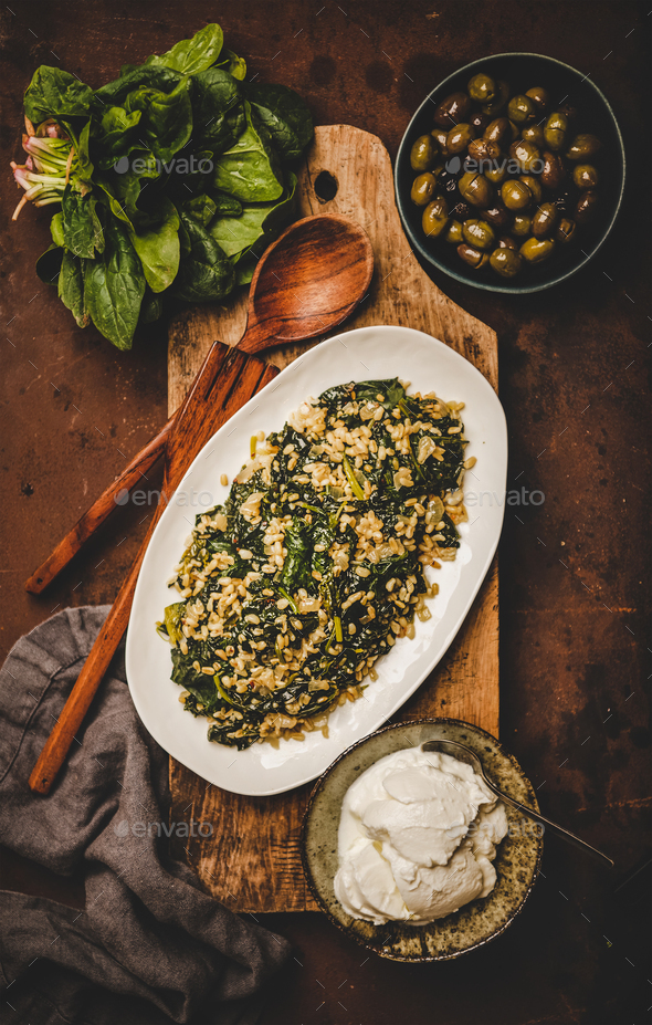 Flat-lay of Turkish traditional dish Bulgur and spinach - Stock Photo - Images