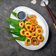 Fried squid rings. Top view, gray background. - PhotoDune Item for Sale