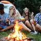 Group of friends camping and sitting around camp fire - PhotoDune Item for Sale