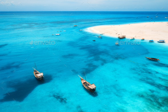 Aerial view of boats on tropical sea coast with sandy beach - Stock Photo - Images