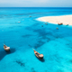 Aerial view of boats on tropical sea coast with sandy beach - PhotoDune Item for Sale