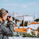 Traveler woman make a picture of Lisbon cityscape. The National Pantheon and the towels of Vicente - PhotoDune Item for Sale