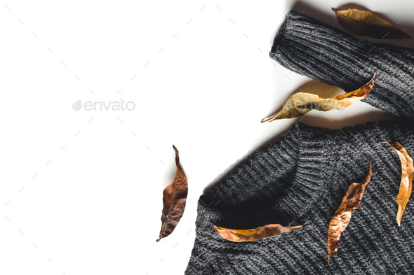 Autumn composition. Knitted woolen sweater dry leaves on white background top view copy space - Stock Photo - Images