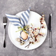 Easter Table Setting with Blossoming Branches on Stone Background. - PhotoDune Item for Sale