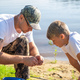 Teamwork. Father and son fishing on a summer weekend. Hobby and sport activity, preparing fish bait - PhotoDune Item for Sale