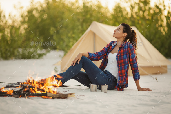 Tourist Woman in the Camp Near Campfire - Stock Photo - Images
