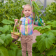 Little adorable girl holding the crop onions in greenhouse - PhotoDune Item for Sale