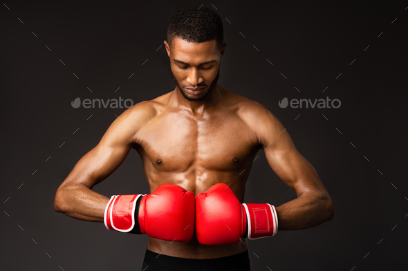 Handsome afro sportsman ready for fight at studio - Stock Photo - Images