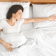 Depressed young woman lying in bed and feeling upset - PhotoDune Item for Sale
