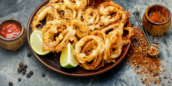 Crispy fried squid rings - Stock Photo - Images