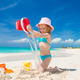 Adorable little girl playing with sand on a perfect tropical beach - PhotoDune Item for Sale