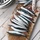 Cleaning fresh anchovies - PhotoDune Item for Sale