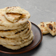 Homemade tasty traditional Pita bread stacked in clay dish on stone kitchen table - PhotoDune Item for Sale