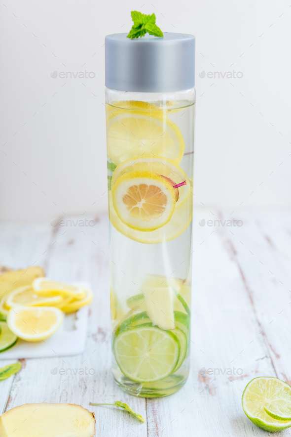 Detox Infused Water with Lemon, Lime, Ginger Lemonade - Stock Photo - Images