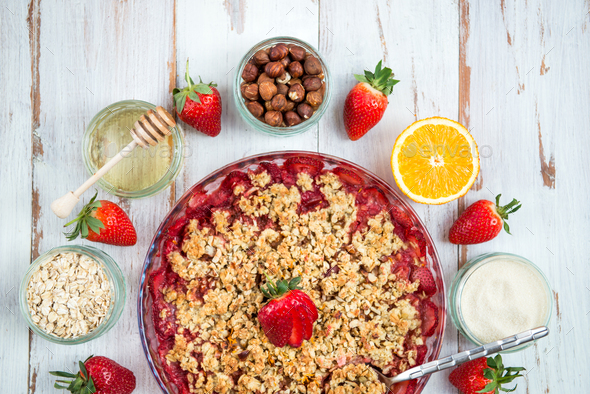 Rhubarb and Strawberry crumble with all ingredients - Stock Photo - Images